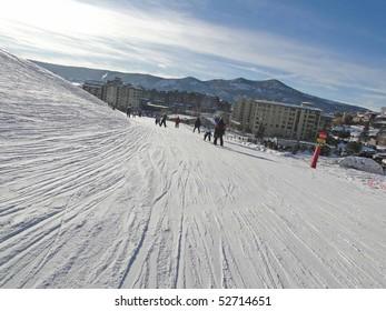 STEAMBOAT SPRINGS, COLORADO - JAN 30 - Skiers slide into the base area on Jan 30, 2010, in Steamboat Springs, Colorado