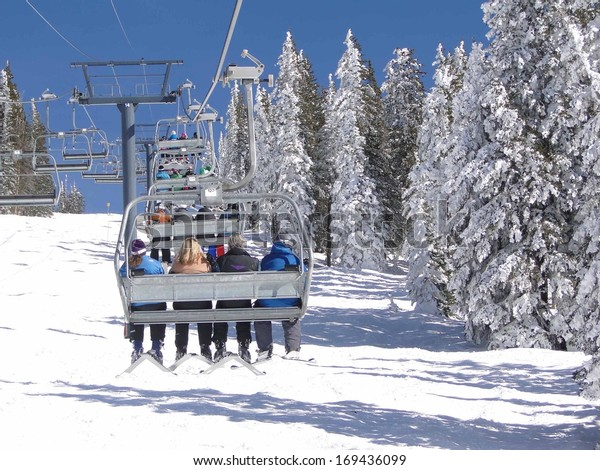 STEAMBOAT SPRINGS, COLORADO - JAN 30 -  Skiers ride the chairlift for another run  on Jan 30, 2010,  in Steamboat Springs, Colorado