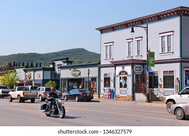 STEAMBOAT SPRINGS, COLORADO - JUNE 19, 2013: People visit downtown Steamboat Springs, Colorado. Steamboat Springs is a popular tourism destination and skiing resort in Colorado.