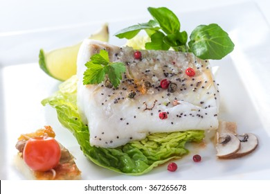 Steamed Atlantic Cod fish with spices and vegetable