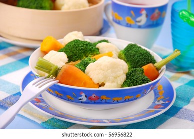 steamed broccoli,carrot and cauliflower  for baby in bowl