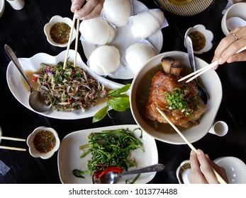 Steamed bun and Pork leg stewed in the gravy and Salad, Yunnan foods on table