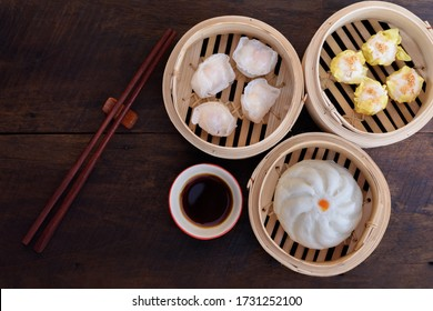 Steamed Bun and Shrimp Shumai, a steamed dish in a bamboo steamer box to enjoy the sweet tenderness of dried sakura shrimp., Name dim sum.