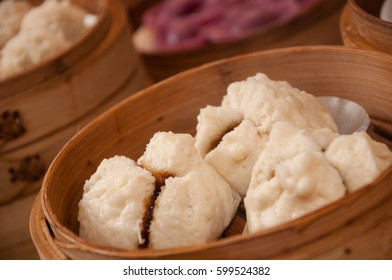 Steamed bun stuffed with barbecued roast pork