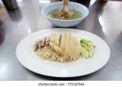 Steamed chicken and white rice, (Hainanese Chicken Rice) served with soup, Thai food recipe, Popular in Thailand.
