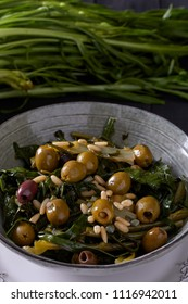 Steamed chicory hearts salad with olives, anchovies, pine seeds, capers and olive oil.