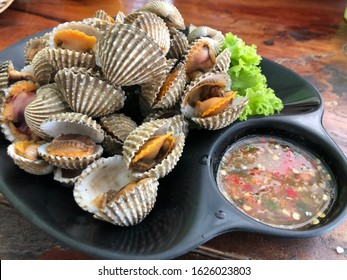 Steamed cockle  with spicy seafood sauce