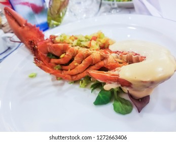 Steamed common lobster cut in half with mayonnaise
