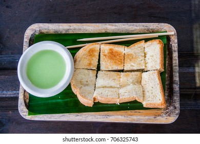 Steamed Custard Toast On Wooden Plate Background.