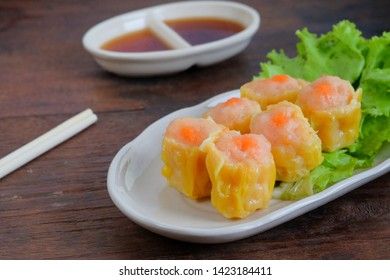 Steamed dumpling with shrimp on wooden table