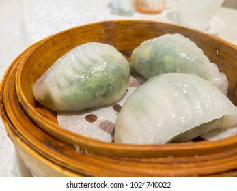 Steamed dumplings with scallop and spinach,Dim sum,Chinese food concept