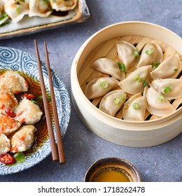 Steamed Dumplings Served with Spring Onions and Sesame Oil
