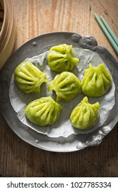 Steamed edamame dim sum. Sticky spinach & rice dumplings, filled with edamame, mint and water chestnuts