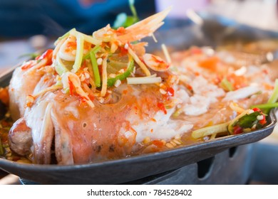 Steamed fish with chili and lemon , Steamed fish is eaten,  spicy food
