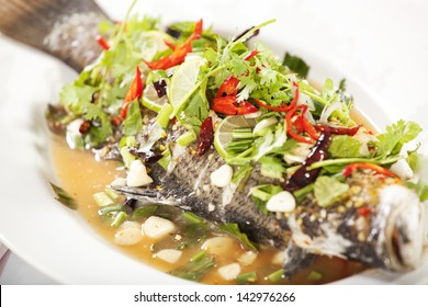 steamed fish, Chinese style steamed fish in spicy sauce