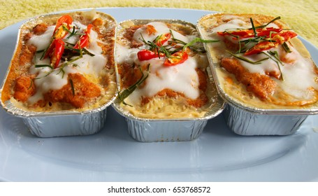 steamed fish with curry paste in aluminium Foil container vessel