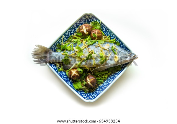 Steamed Fish ingredients in blue plate on white background