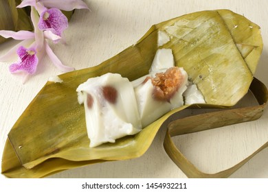 Steamed flour with sweet coconut filling ( Khanom Sai Sai ) on banana leaves.