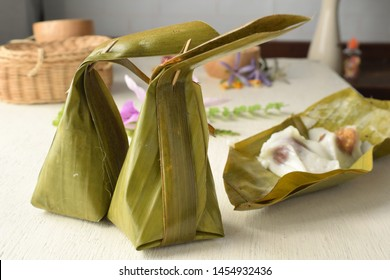 Steamed flour with sweet coconut filling ( Khanom Sai Sai ) in banana leaf wrapped.