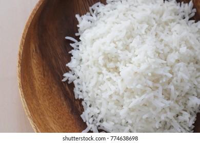 Steamed Jasmine rice on wooden plate