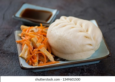 Steamed korean pjan-se bun with salad over grey stone background, studio shot