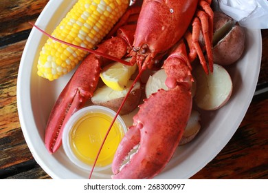 Steamed lobster with potatoes, corn and drawn butter