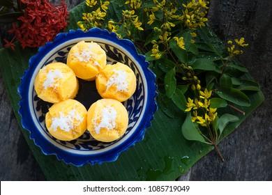 Steamed Pumpkin Cake (Thai Dessert) - Kanom Fak Thong. make from pumpkin, sugar, Flour, tapioca flour, grated coconut, salt and coconut milk.