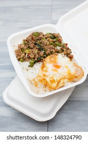 Steamed rice topped with fried pork and fired egg