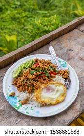 Steamed Rice topped with stir fried Thai basil with minced pork and a fried egg.Traditional Thai food.Popular Thai food.Spicy food.Nice meal.Favorite menu.Basic Thai food.Pad Kra Pao moo.