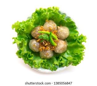 Steamed Sago filling with pork and seasoned beans tasty sweet and salty on top with deep fried garlic and green chili-Recovered top view isolate white background