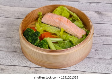 Steamed salmon with vegetables - cauliflower, salad and carrot