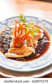Steamed snapper with soy sauce and ginger paprika on dish, cut into pieces is easy to eat