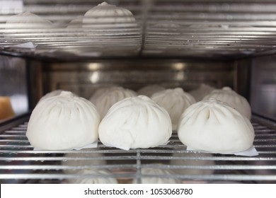steamed stuff bun favorite tradtional chinese food in asia.It is a popular snack sold mostly in Chinese restaurants.Another name is Siopao made from a combination of pork, chicken, beef, shrimp.