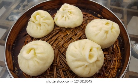 steamed stuffed bun with assorted vegetables inside, most popular snacks in China