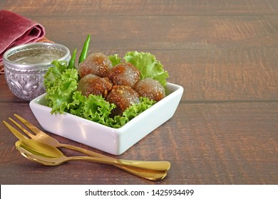 """Steamed tapioca (Sago) balls with pork and peanut filling, the Famous traditional Thai appetizer / street food name """"Saku Sai Moo), served with vegetables and chili. Sago Pearl or Tapioca pork. Space"""