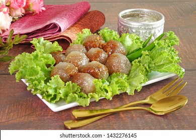 """Steamed tapioca (Sago) balls with pork and peanut filling, the Famous traditional Thai appetizer / street food name """"Saku Sai Moo), served with vegetables and chili. Sago Pearl or Tapioca pork."""