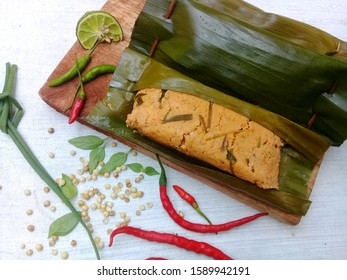 Steamed Tempe is given the typical spice flavor with delicious flavor
