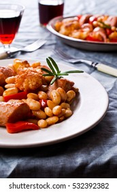Steamed vegetables with beans and sausage in tomato sauce. Selective focus.