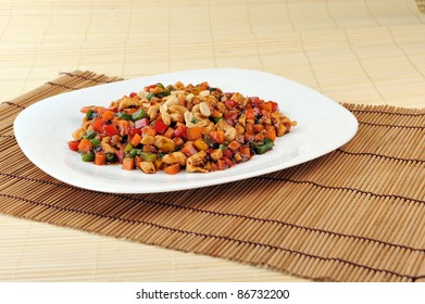 steamed vegetables and meat with  peanut on plate. Chinese cuisine.