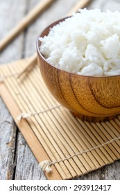 Steamed white rice in wooden cup on wooden , Thailand cooked rice in wooden bowl
