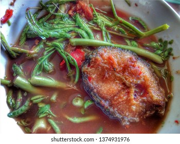 Steamed whole fish with sauce , Sour soup made of Tamarind Paste