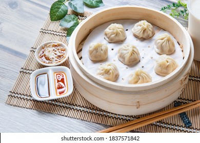 Steamed xiaolongbao served in a traditional steaming basket