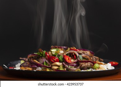 steaming chicken sizzler with noodles