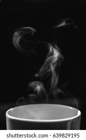 Steaming coffee cup, black and white