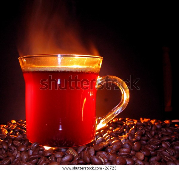 Steaming coffee on coffee beans