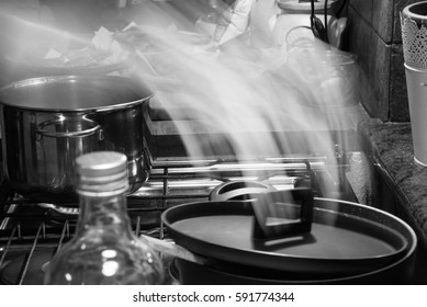 A steaming cover in an old kitchen of Alps