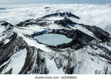 Steaming crater lake of Mt Ruapehu in the North Island of New Zealand. Aerial shot.
