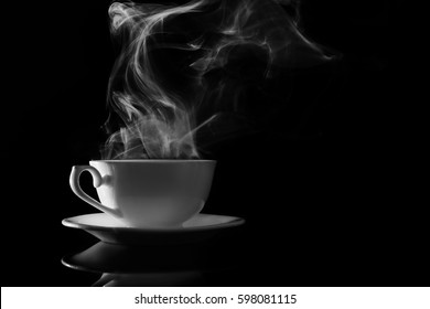 Steaming cup of coffee on black background