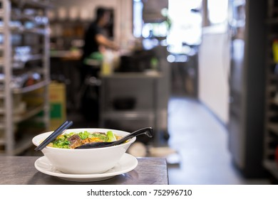 A steaming hot bowl of pho tai (brisket).