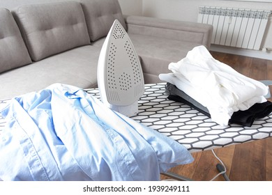 Steaming iron on ironing board
